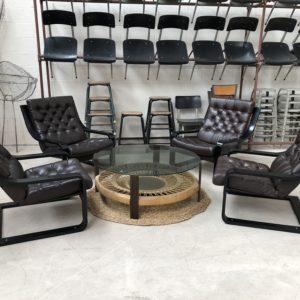 Suite de 4 fauteuils en cuir années 80