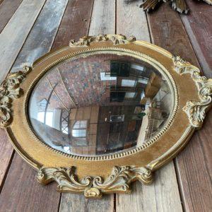 Ancien miroir doré convexe